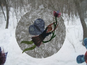 A little spring fairy with the winter woods behind