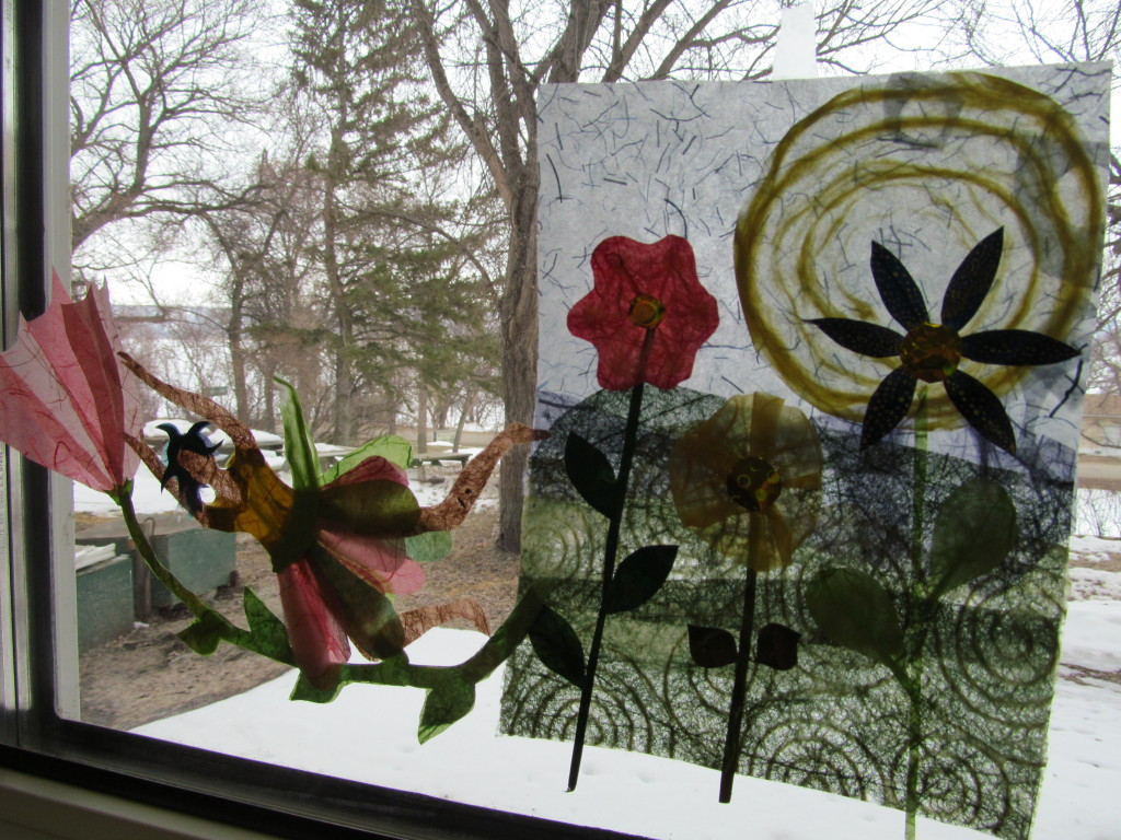 spring inside the window, winter outside!! (Linda's sun & flowers on the right)