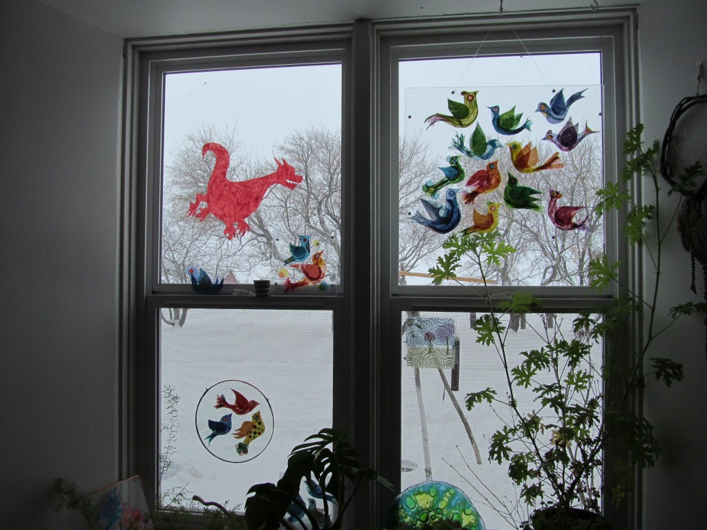 the basic dragon joins the birds on the window