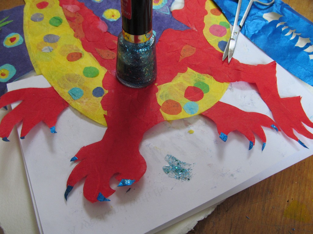 LeeAnn's dragon gets a pedicure. Special nails from the cigarette foils she so kindly donated, sharpened with a file and sparkling with glitter nail polish.