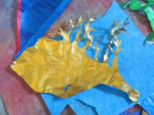 a tree begins to grow from beautiful and fragile gold foil
