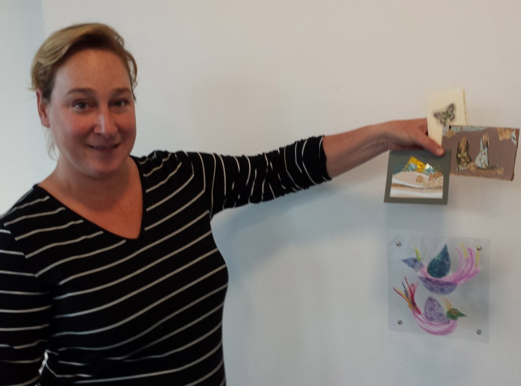Darlene holding her bird panel and her exquisite miniature cards