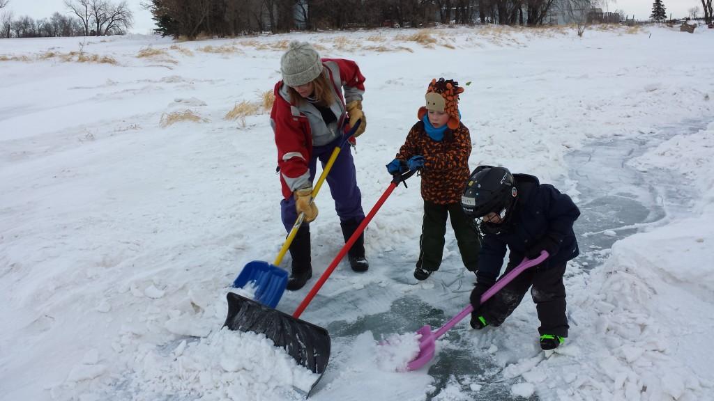 Debra and the boys shovelling hard