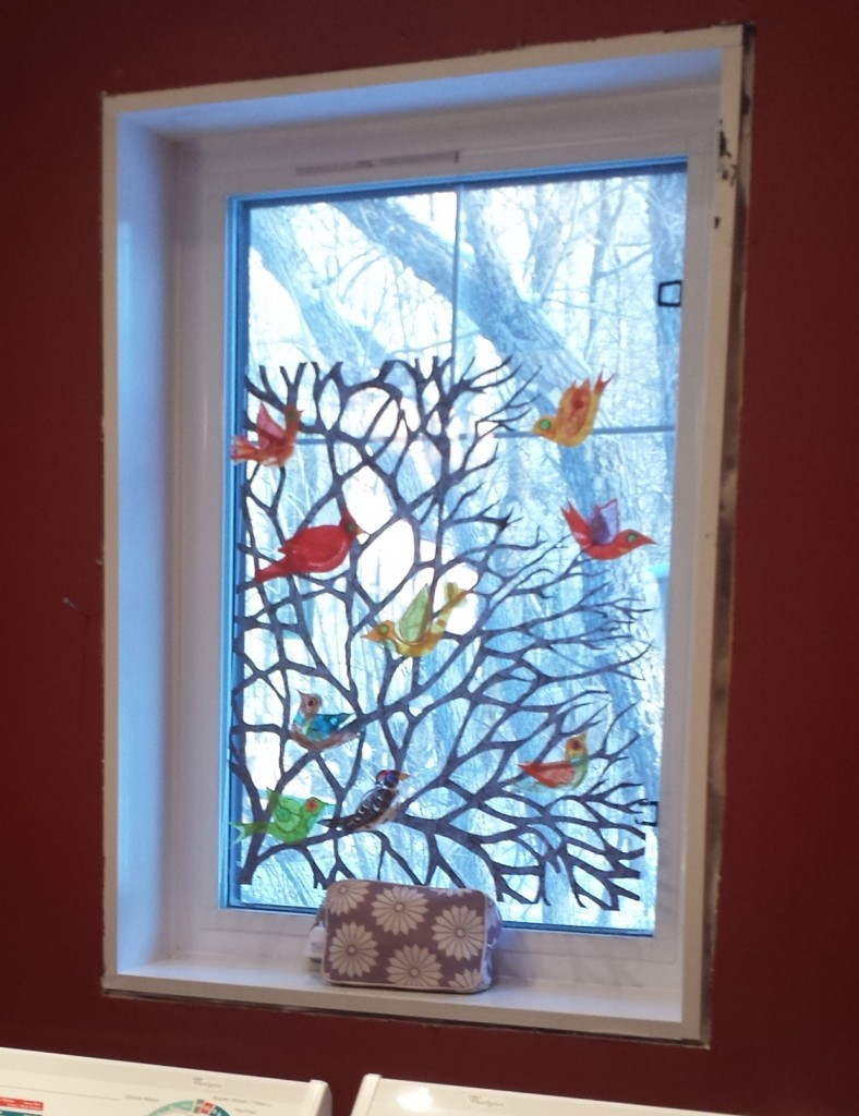 I taped the branch with a simple arrangement of birds to the cottage