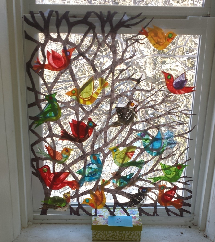 I created more red birds and sent them mock ups of different arrangements of birds on the tree